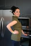 Girl at home. Young woman standing in her kitchen Royalty Free Stock Photo