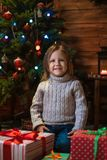 Girl at home with a Christmas tree, presents and candles celebra. Little girl at home with a Christmas tree, presents and candles celebrating christmas Stock Image