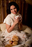 Girl in the home with a cup of tea Stock Photography