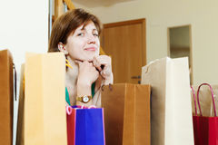 Girl at home with few shopping bags Royalty Free Stock Photography
