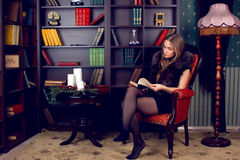 Girl in the home library Stock Image