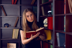 Girl in the home library Stock Images