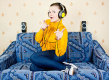 The girl at home listening to music Royalty Free Stock Photo
