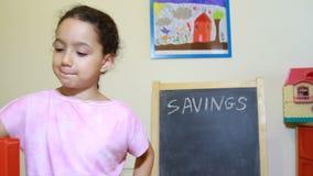 Girl at home saving money stock video
