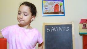 Girl at home saving money stock footage