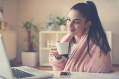Girl at home sitting on floor holding cup of coffee and royalty free stock images