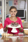 Girl With Homemade Cupcakes In Kitchen Royalty Free Stock Photos