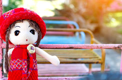 Girl homemade doll sit on a toy train. Stock Photo