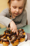 Girl with homemade muffins Stock Images