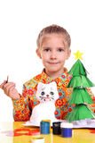 Girl with homemade toys Stock Image