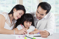 Girl in homeschooling with their parents Royalty Free Stock Photography