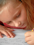Girl with homework Stock Images