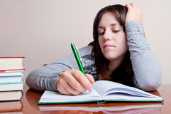 Girl and homework Royalty Free Stock Photo