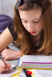Girl with homework Royalty Free Stock Image
