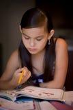 Girl with homework stock image