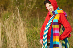 Girl in hood with multi-colored scarfs Royalty Free Stock Image