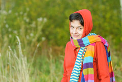 Girl in hood with multi-colored scarfs Stock Image