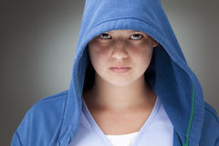 Girl in a hooded jacket Royalty Free Stock Image