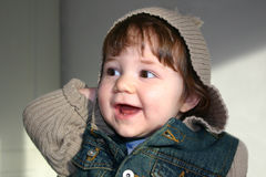 Girl with Hooded Jacket. Little Girl with a Hooded Jacket having fun royalty free stock photography