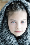 Girl in Hooded Sweater Stock Photo