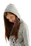 Girl in Hooded Sweatshirt. Girl Teen with Long Brown Hair in Casual Gray Hooded Sweatshirt on white background stock photo