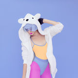 Girl in hoodie Teddy Bear on a blue background. Royalty Free Stock Photos