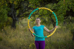 Girl with hoop Stock Photography
