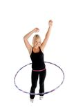 Girl Hooping. Girl working out with a hula hoop Royalty Free Stock Image