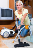 Girl hoovering in living room Royalty Free Stock Images