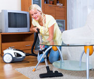 Girl hoovering in living room Royalty Free Stock Photo