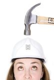 Girl hoping safety helmet works Royalty Free Stock Photos