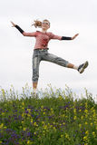 Girl hopping outdoors Stock Photography