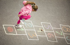 Girl on the hopscotch Stock Image