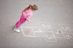Girl on the hopscotch Stock Images