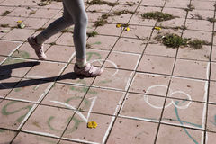 Girl on the hopscotch Stock Photography