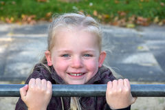 Girl at horizontal bar Stock Photography