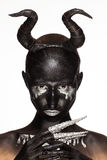 Girl with horns on his head Stock Images