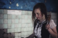 Girl from horror movie with knife Stock Photos
