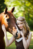 Girl with horse. A portrait of a caucasian girl with her horse Royalty Free Stock Images