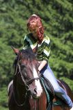 Girl on  horse. Girl on chestnut horse in summer day Royalty Free Stock Images