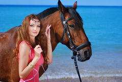 The girl and horse. A portrait of a caucasian girl with her horse Stock Photo