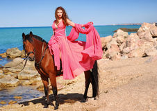 The girl and horse. A portrait of a caucasian girl with her horse Royalty Free Stock Images