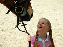 Girl with horse. A happy girl looking at her horse Stock Photos