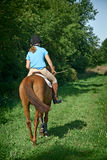 Girl and Horse. Girl taking a casual ride on her horse in summer stock images