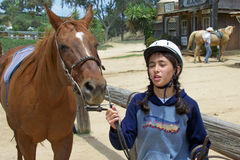 Girl with Horse. Pretty girl walking next to her horse Stock Image