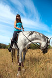 Girl on a horse Royalty Free Stock Image