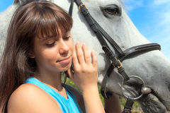 Girl on a horse Stock Images