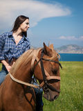 Girl on horse Stock Photo