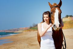 Girl with horse Stock Image