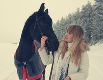 Girl with a horse Stock Image